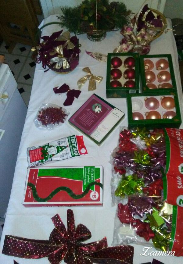 Assorted burgundy Christmas decorations ornaments lighted Garland package bows plus more
