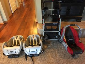 Photo Graco infant car seat with compatible stroller and two compatible car seat bases.