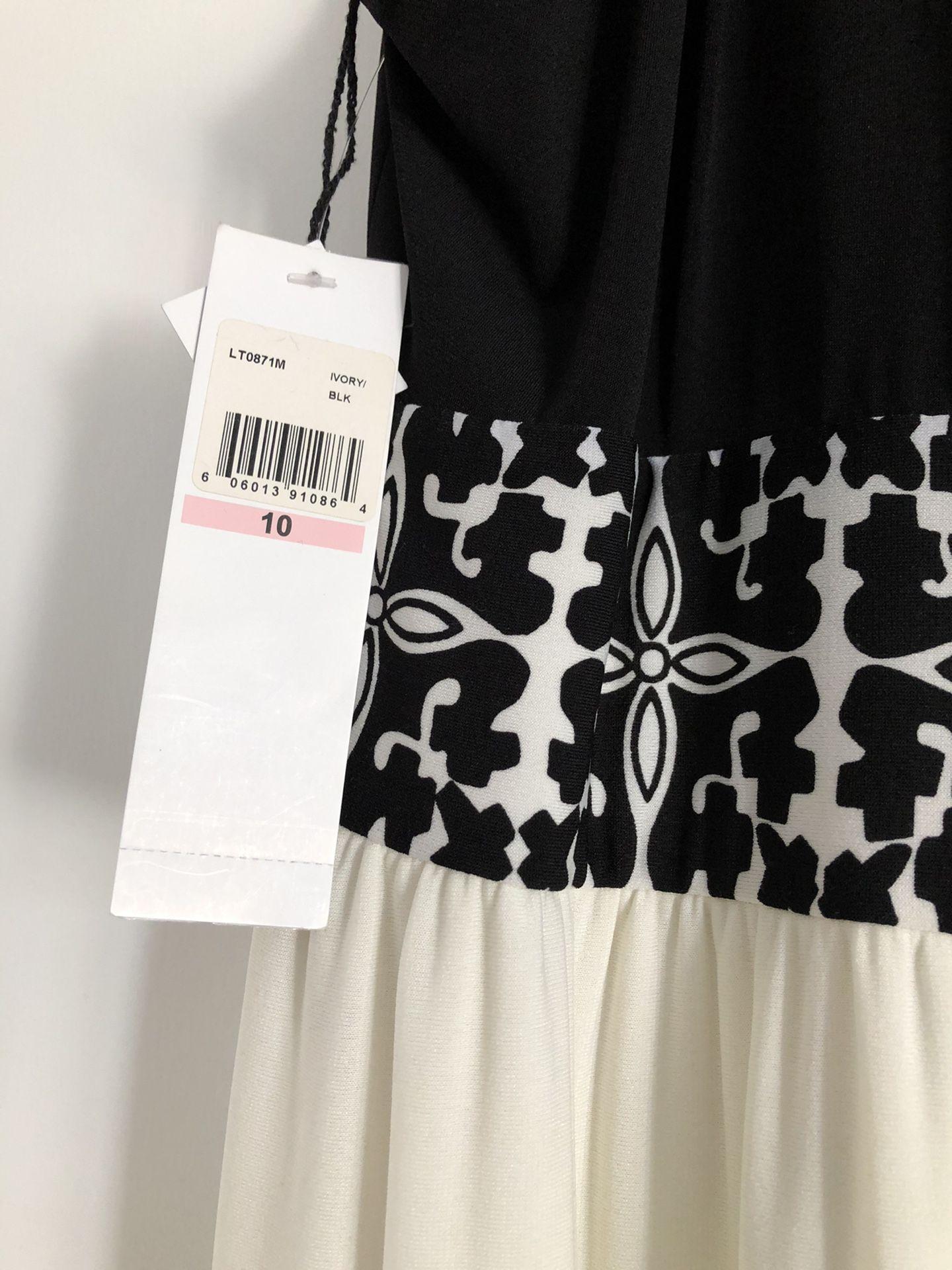 Beautiful black and white dress .