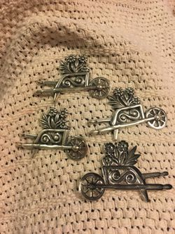 Metal wheelbarrow with flowers , arts and craft , pins , put on the fridge with a magnet . $2.50each . Great for Mother's Day Thumbnail