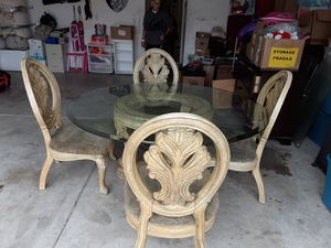 Photo USED Rusty paint looking light beige wood table with Glass top and 4 chairs