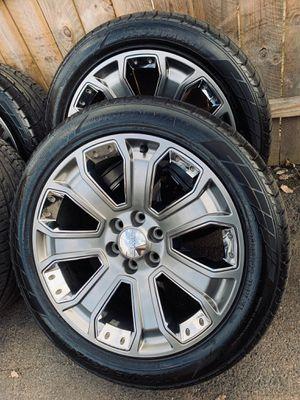 Photo 22 inch oem gm wheels with like new tires (hablo español)