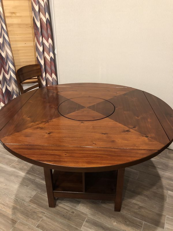 79a588871e42 Dining table with lazy Susan and four chairs for Sale in Evans