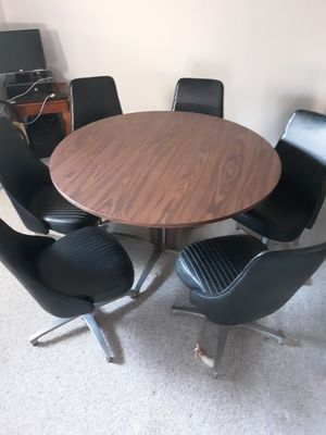 Brown wooden round table with six chairs for Sale in Grottoes, VA