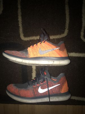 Orange and grey Nike running shoes. for Sale in Springfield, VA