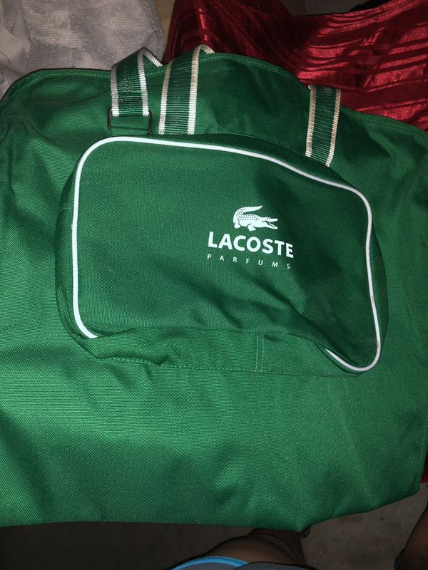 b565d02205 Lacoste parfums essentials luggage collection garment bag green &white