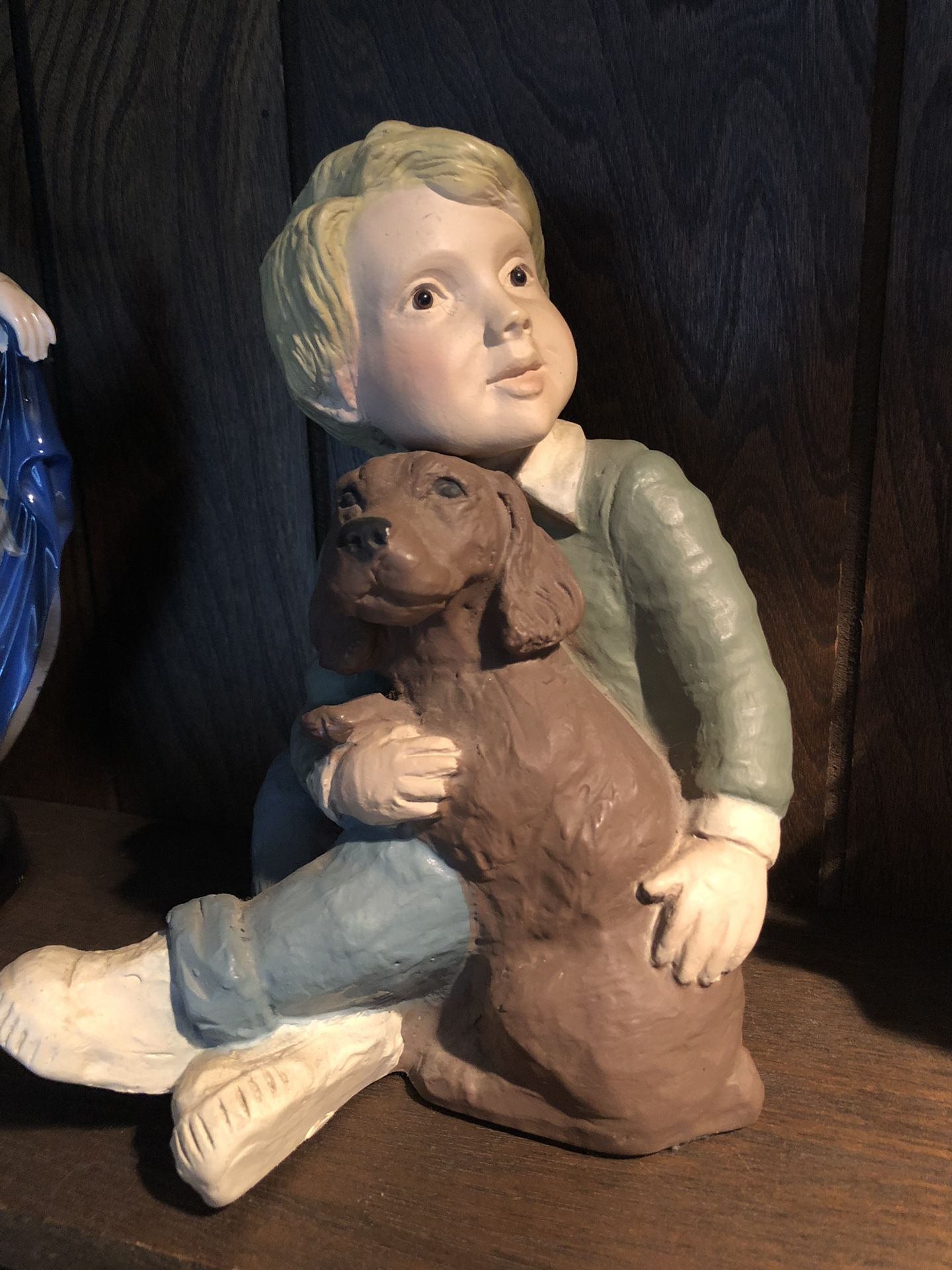 Boy with dog statue figurine