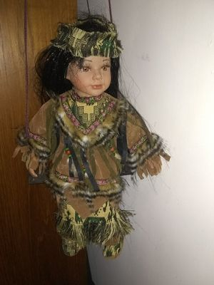 Porcelain doll on swing for Sale in Alexandria, VA