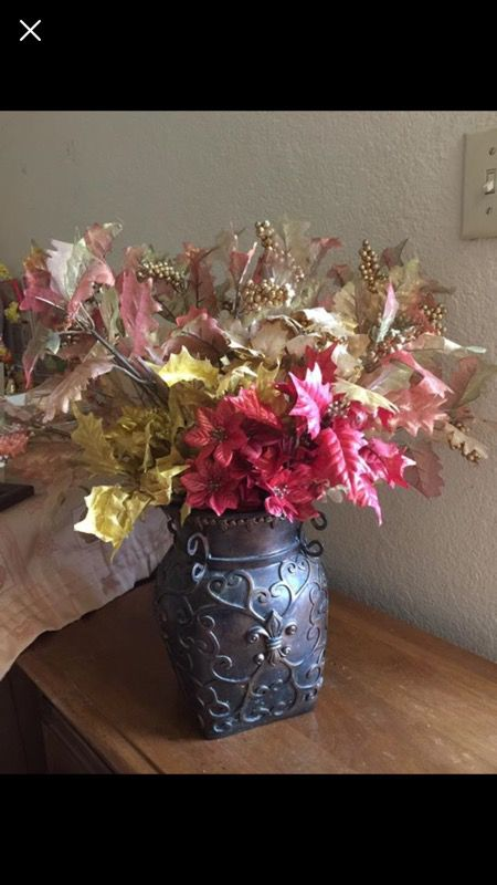 Flower vase and lot of fall leaves