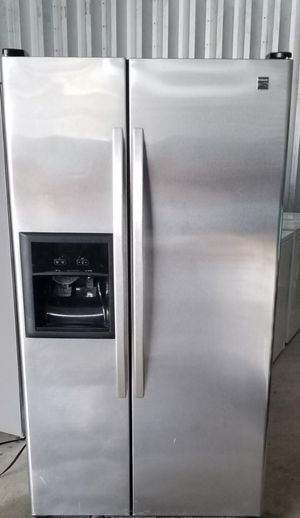 Photo Beautiful Kenmore stainless steel side-by-side refrigerator