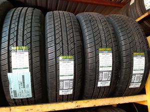 Photo New tires set 235 75 15