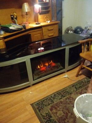 A fireplace with electic haeter build in china red oak desk for sale great condtion for Sale in Pittsburgh, PA