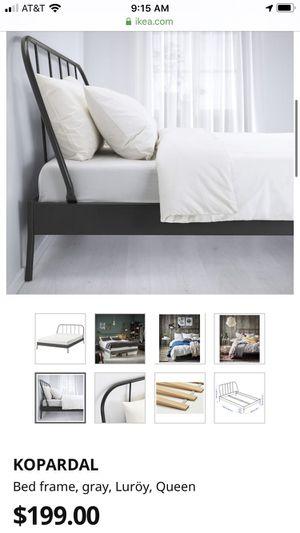 Photo IKEA gray metal queen bed frame