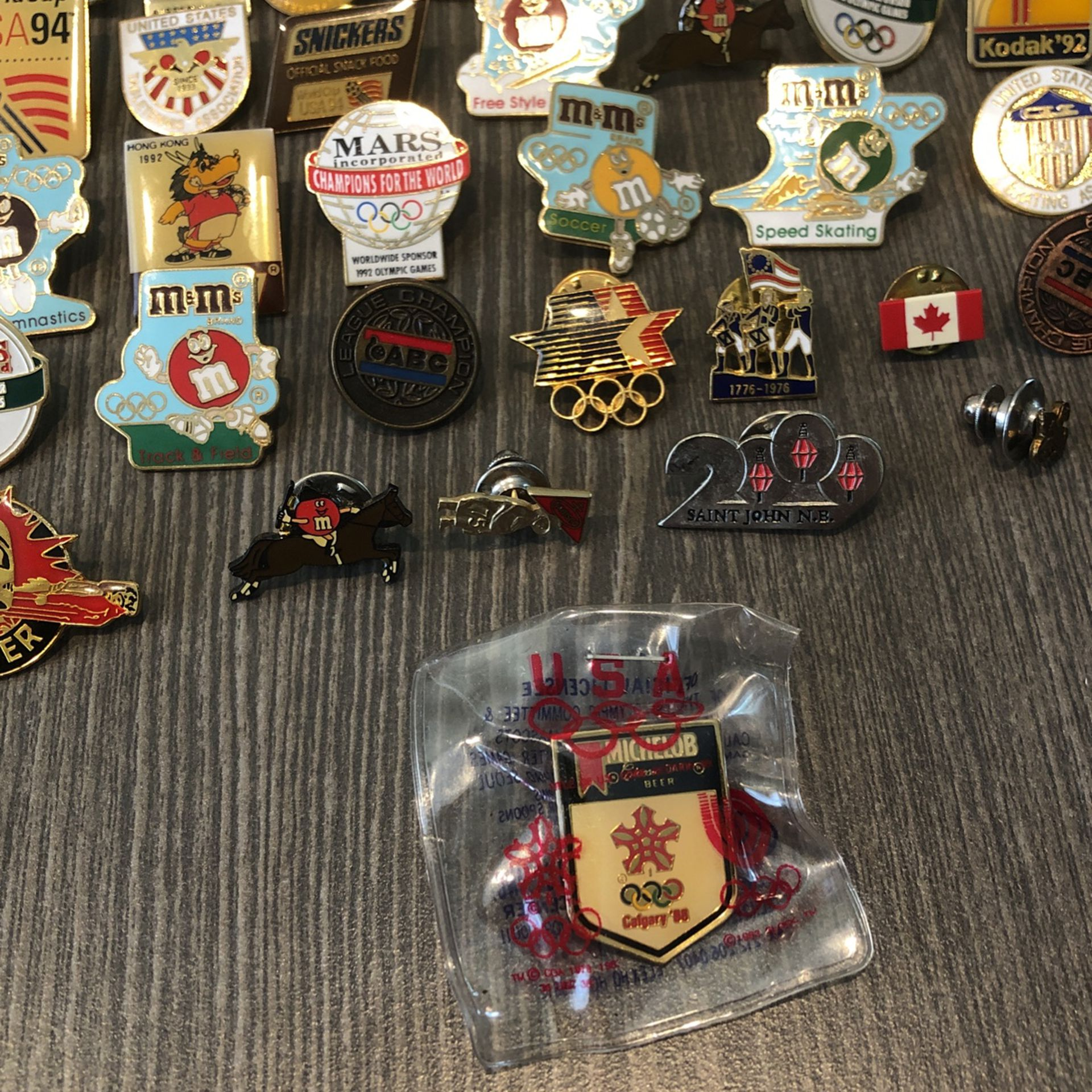 45 sponsored olympic metal collectors pins.    Various sporting events of different years