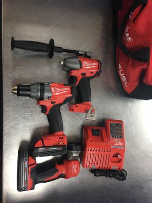 Milwaukee drill/driver, impact wrench and work light set for Sale in Orlando, FL