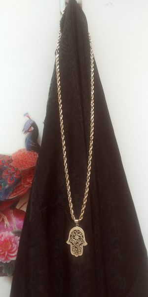 Photo 10 k real gold. Hollow rope chain 26 inches. Pendent is 10 k gold also