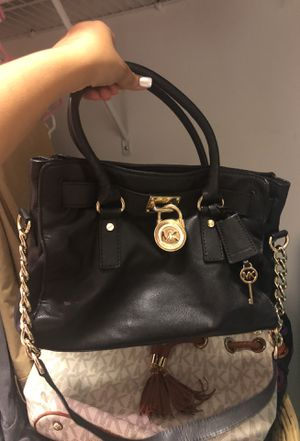 784dade0bbf3 Black and gold Michael Kors bag for Sale in Boca Raton