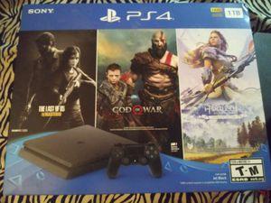 Photo PS4 1 TB plus 3 games INTERNET READY!!!