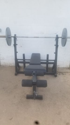 Bench and Olympic bar weights for Sale in Phoenix, AZ