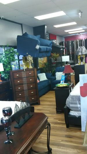 Photo Nice two piece couch and love seat $39 down
