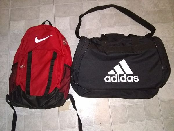 Red Nike book bag with black adidas duffle bag for Sale in Port St ... 60598f3ba86bd