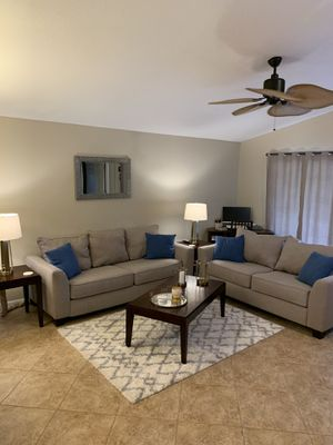 Photo Beautiful Rooms to go couch and table set!