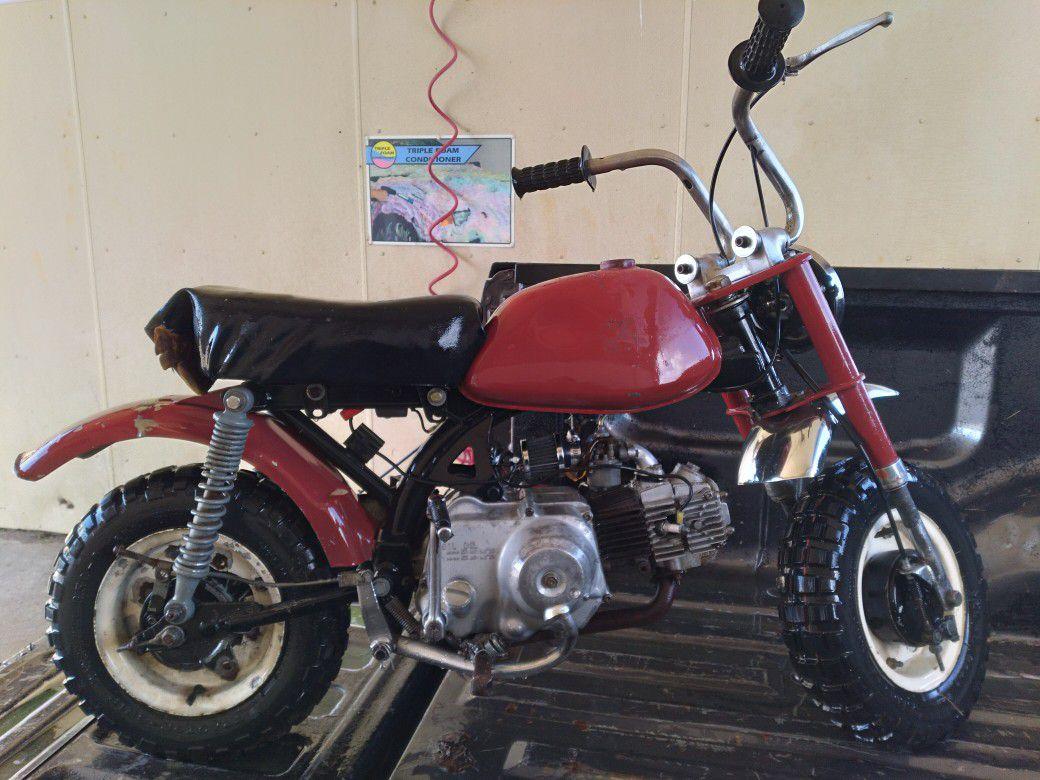 Photo Buying Mini Bikes. Dirt Bikes. Go Karts