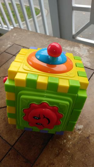 green, orange, and blue baby sensory puzzle cube toy for Sale in Morrisville, NC
