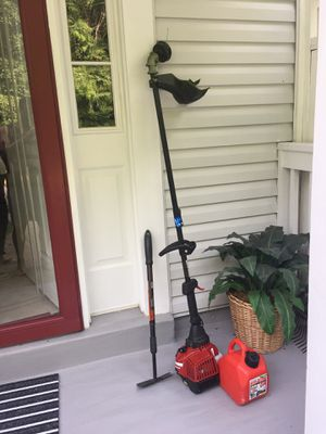 Mini power trimmer and edge included one gallon gas container and Hoe for Sale in Lake Ridge, VA