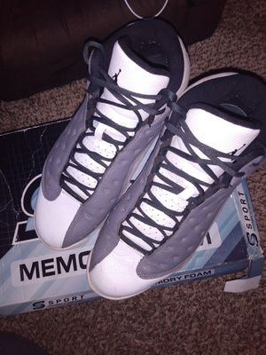 Photo Size 12 gray and white Jordan retro 13s
