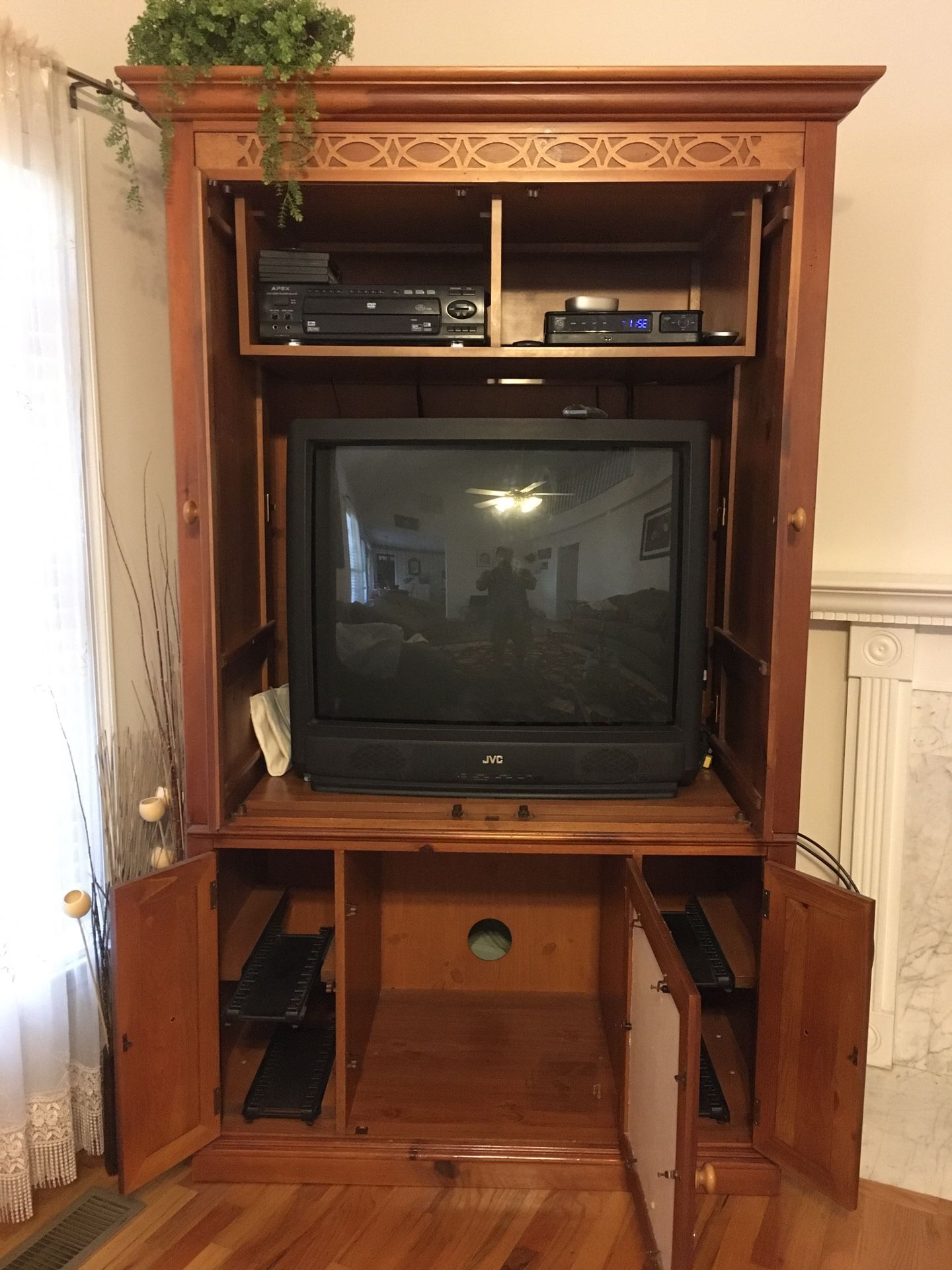 Entertainment Center W/ Two TVs.