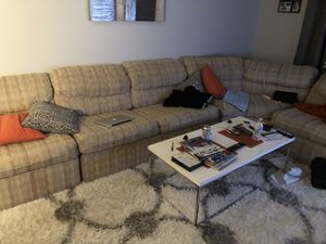 Sectional couch for free it pulls out as a bed and has two recliners on the side seats for Sale in Rockville, MD