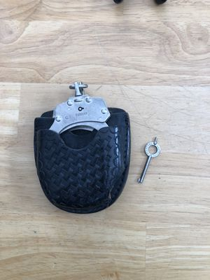 Handcuffs with key And belt holder for Sale in Apex, NC