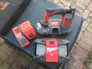 Bandsaw radio charger in one battery for $75 for Sale in Lakewood, WA