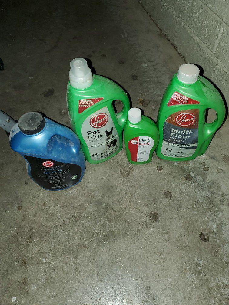 Four Bottles Of Hoover Multifloor Plus And Hoover  Pet Plus