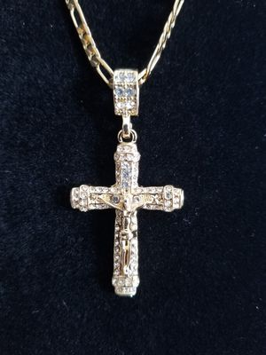 Photo 14k gold filled jesus cross pendant on figaro chain.