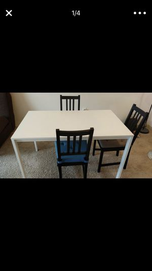Dining table with 3 chairs and 3 chair cushions for Sale in Charlottesville, VA