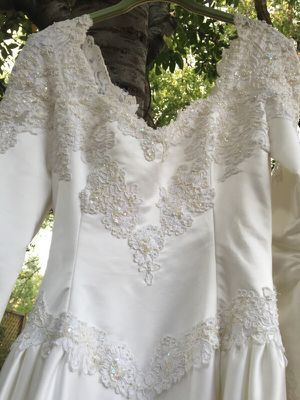 Stunning new with tag wedding dress for Sale in Salt Lake City, UT