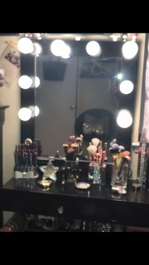 Photo Vanity light up mirror with on off switch and plug in outlet.