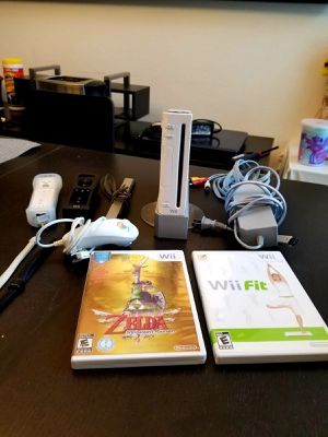 WII CONSOLE (USED) + 2 B/W CONTROLLERS + MOTION STICK (OPTIONAL GAMES) for Sale in Orlando, FL