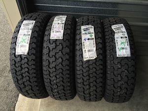 Photo New 235/75/15 Goodyear wrangler A/T tires