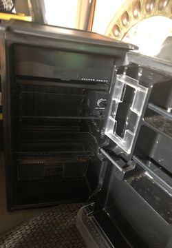 Slightly used Sanyo smaller type refrigerator. Great deal! Thumbnail