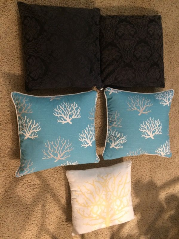 Throw pillows: teal with trees are down. All have zippers with removable inserts