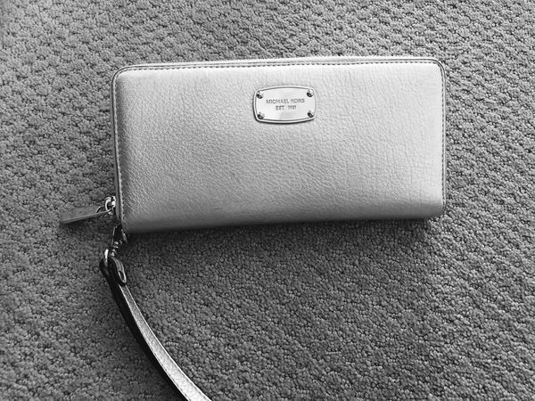 03956be39bacd6 Michael Kors silver jet set large wallet with wristlet strap. Greensboro ...