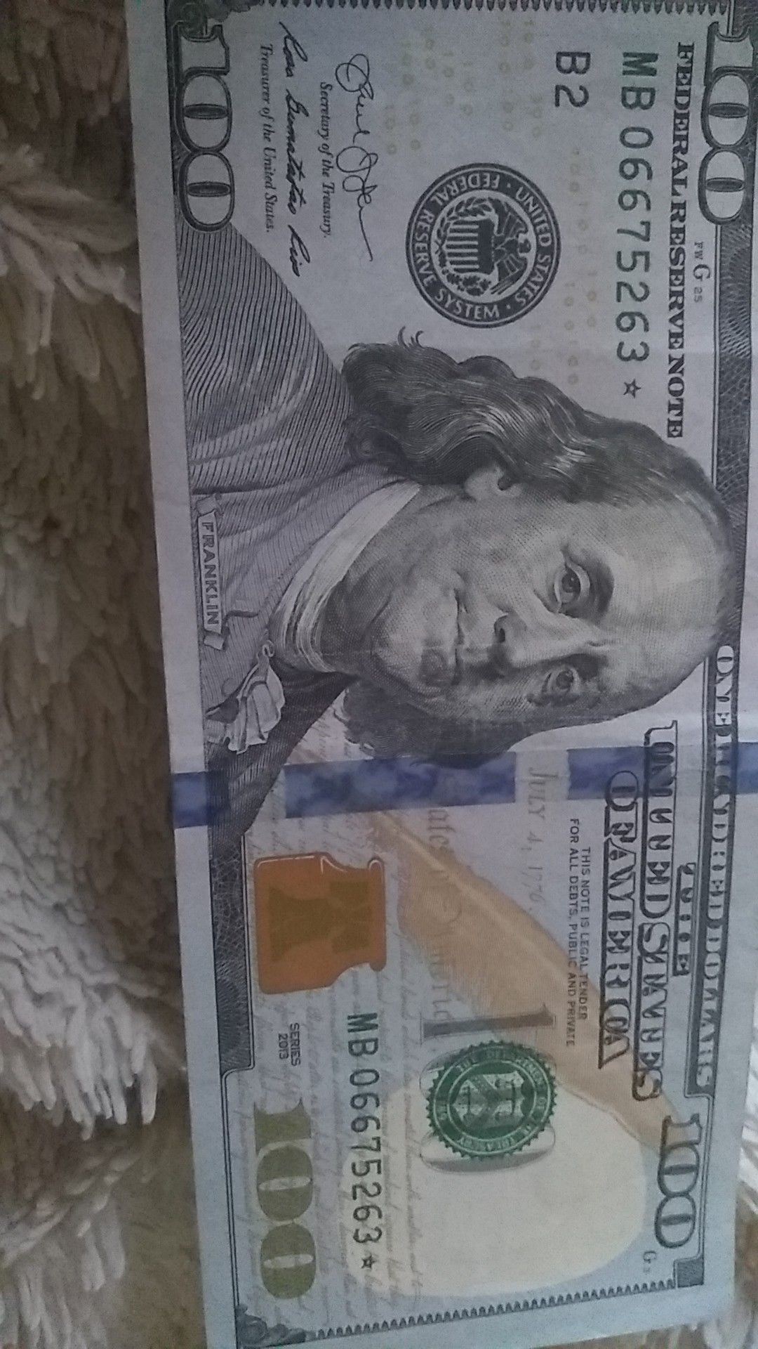100$ bill with * serial code