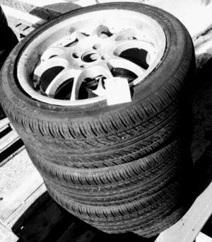 Photo (4) 205 50 r 17 tires on 4 lug rims.