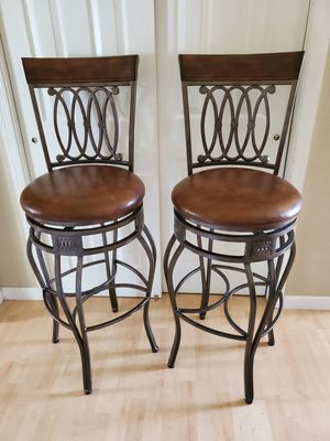 Photo Two Beautiful Leather, Wood and Rod Iron Heavy Duty Bar Stools 32in from Floor to seat both for 99.00