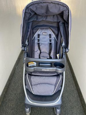 Photo Chicco bravo trio system. Car seat and base with quick fold stroller