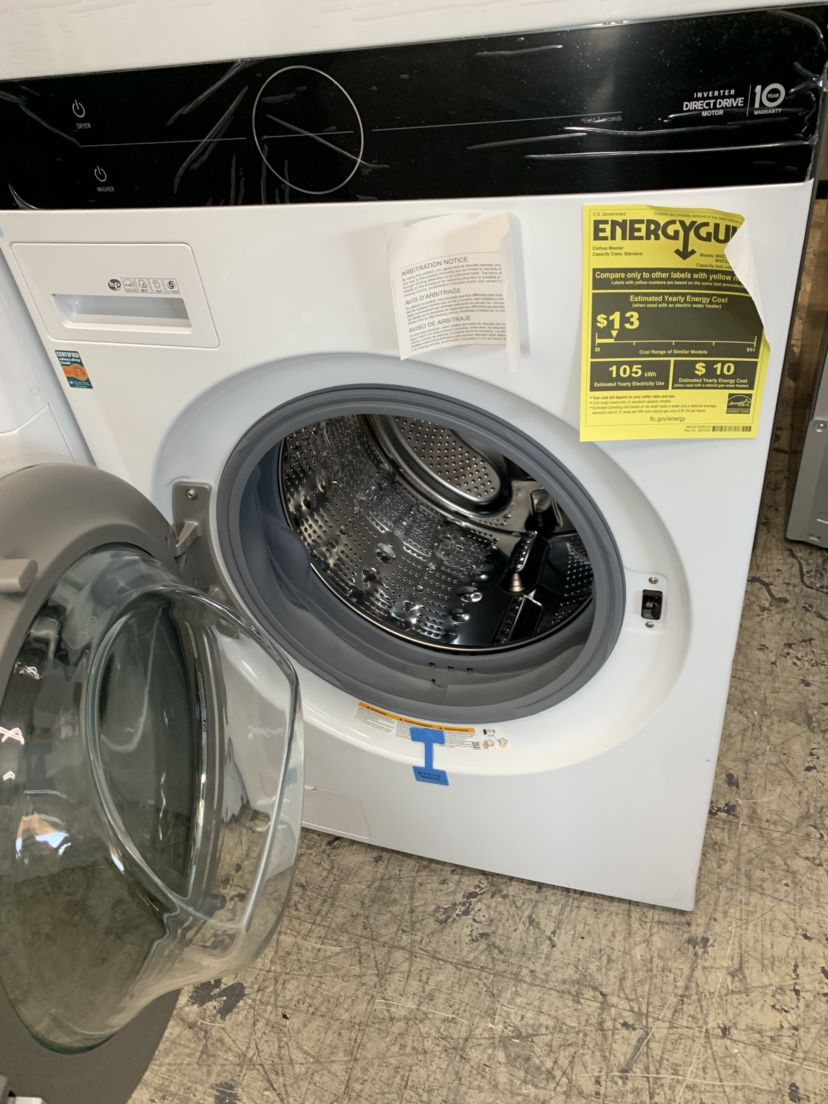 """LG White Stacked 27"""" Washer And Dryer Gas With Steam High Efficiency"""