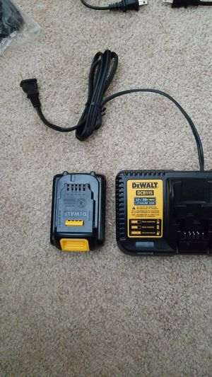 Photo Dewalt 12/20 volt charger and battery